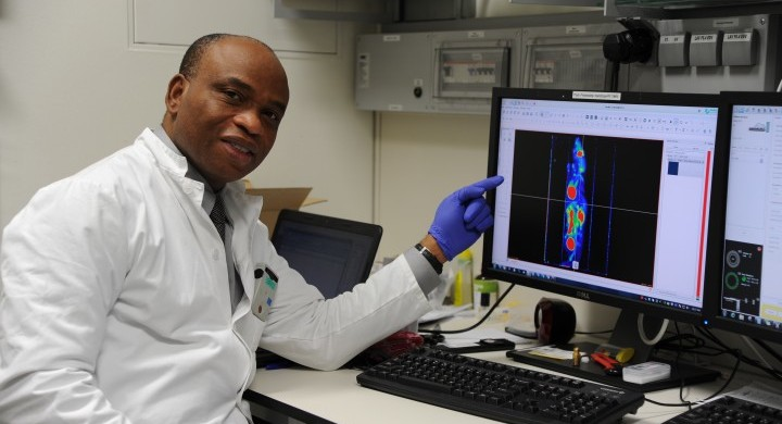 Academician-Dr-Philip-Njemanze-looking-and-PET-image-of-experimental-mice-720x479