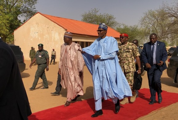 Update: Breaking: 'Senile' Buhari walks red Carpet in condolence visit to Dapchi victims, with 110 girls/students still missing–Reports